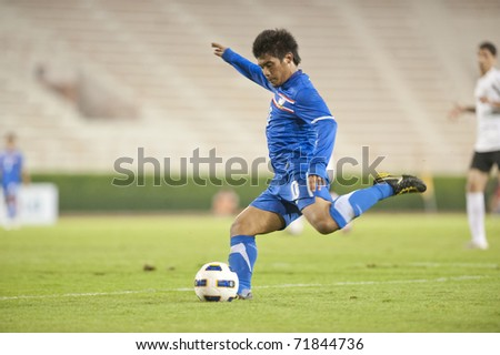 BANGKOK, THAILAND- FEB 23 : An unidentified player in action during FIFA Olympic Football match between Thailand vs Palestine on February 23, 2010 in Supachalasai National Stadium in Bangkok, Thailand. - stock photo