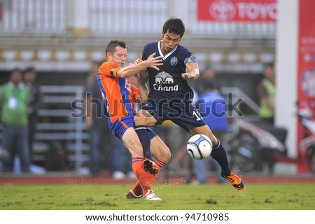 BANGKOK,THAILAND-FEB 4:Apichet Puttan (blue) of Buriram PEA in action during the Toyota league cup final between Buriram PEA and Thai Port FC.at National Stadium on Feb 4, 2012 in Bangkok, Thailand.