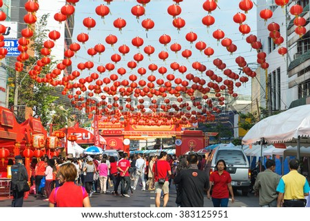 BANGKOK, THAILAND - 8 FEB 2016: Dozens of Chinese Paper Lanterns Suspended over a Street in Chinatown during Chinese new year celebration.