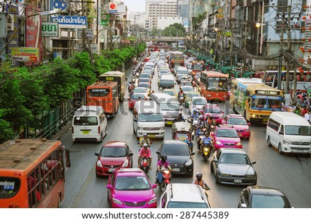 BANGKOK, THAILAND - FEB 19, 2015: Everyday street scene with transport and the with unidentified people. Bangkok is one of the most important economic and transport centres in South-East Asia - stock photo