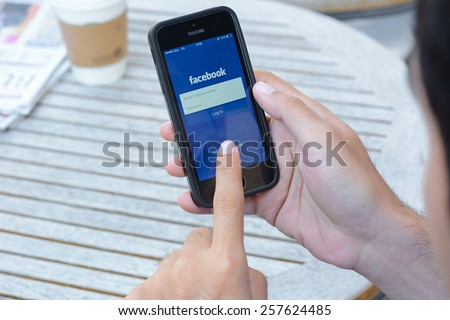 Bangkok, Thailand - Feb 26, 2015 : Fackbook application on iphone , Facebook is one of the most famous social networking website from USA that also has application on smart phones. - stock photo
