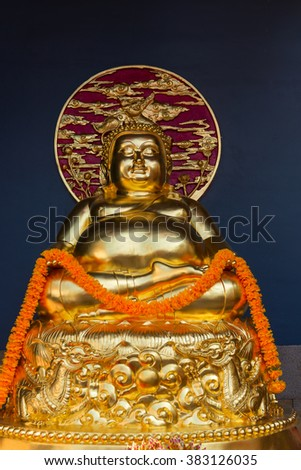 BANGKOK, THAILAND - 8 FEB 2016: Intricately Detailed, Gold fat Buddha Sculpture at Canton chinese Shrine temple - stock photo