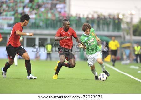 BANGKOK THAILAND- FEB 26: M.Byrne (c) in action in Thai Premier League (TPL) between Bangkok Glass (green) vs Muangthong Utd (red) on February 26, 2011 at Leo Stadium in Bangkok - stock photo