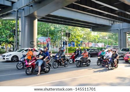 BANGKOK, THAILAND - FEB 17: Many motorcyclists move along Thanon Silom near Lumpini Park, Feb 17, 2013, Bangkok, Thailand. Motorbike is the most popular and available transportation in South Asia. - stock photo