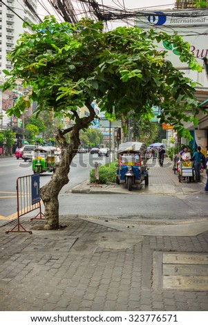 BANGKOK, THAILAND - FEB 20, 2015: Ordinary street on the outskirts of Bangkok. While in Bangkok lives of 8.5 million people, there are and uncrowded streets - stock photo