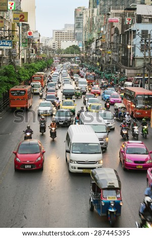 BANGKOK, THAILAND - FEB 20, 2015: Ordinary street scene with transport and the with unidentified people. Bangkok is one of the most important economic and transport centres in South-East Asia - stock photo