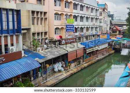 BANGKOK, THAILAND - FEB 20, 2015: Rather poor quarter and the canal flowing through it. In Bangkok, you can often see the houses standing just above the water channel - stock photo
