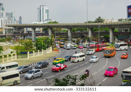 BANGKOK, THAILAND - FEB 20, 2015: Scene with the transport on one of the squares of Bangkok. Bangkok is one of the most important economic and transport centres in South-East Asia - stock photo