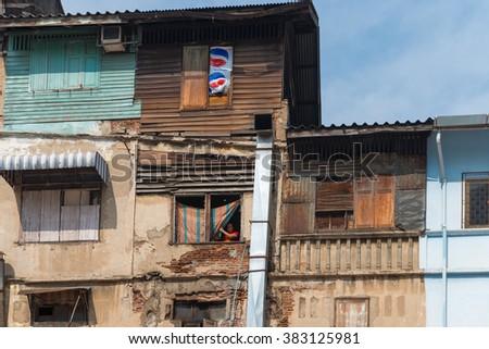 BANGKOK, THAILAND - 8 FEB 2016: Tumbledown Housing in a Poverty Stricken Section of Bangkok - stock photo