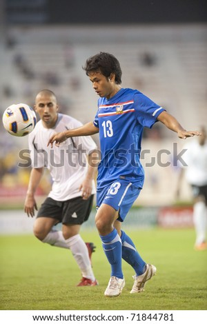 BANGKOK, THAILAND- FEB 23 : Unidentified players in action during FIFA Olympic Football match between Thailand  vs  Palestine on February 23, 2010 in Supachalasai National Stadium in Bangkok, Thailand.