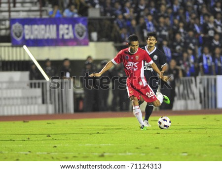 BANGKOK THAILAND- FEB 12: Unidentified players in Thai Premier League (TPL) between  between BEC Tero  vs  Burirum FC (Blue) on February 12, 2010 in Thep Hatsadin Stadium Bangkok Thailand - stock photo