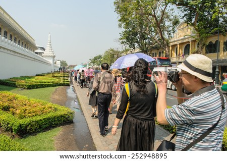 BANGKOK, THAILAND- 8 FEB: Unidentified tourists walk around Wat Phra Kaew in cloudy day on Feb 8, 2015, Temple of the Emerald Buddha is regarded as the most sacred Buddhist temple in Bangkok, Thailand - stock photo