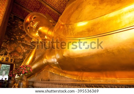 BANGKOK, THAILAND - FEB 14: View of the Reclining Buddha gold statue inside famous Wat Pho temple on February 14, 2015. Wat Pho is a Buddhist temple complex founded in 16th century - stock photo