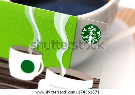 BANGKOK, THAILAND - FEBRUARY 2, 2014: A new Starbucks card available for member in Thailand. Starbucks is the largest coffee franchises in the world, currently. - stock photo