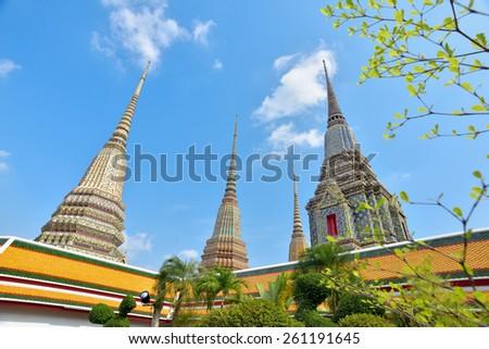 BANGKOK, THAILAND - FEBRUARY 19, 2015: Ancient stupas at Wat Pho (Wat Phra Chetupon Vimolmangklararm) in Bangkok, Thailand. - stock photo