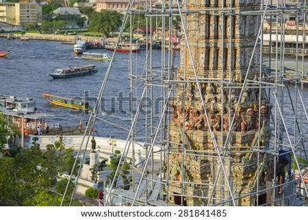 BANGKOK, THAILAND - FEBRUARY 19, 2015: Closeup details on top of pagoda at Wat Arun during restoration in Bangkok, Thailand. - stock photo