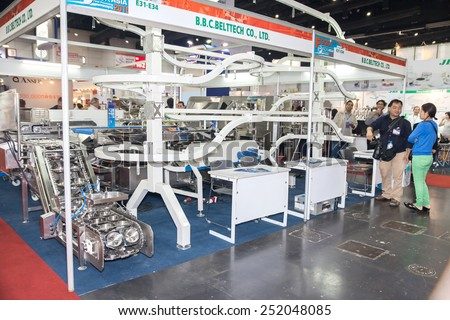 BANGKOK ,THAILAND - FEBRUARY 7: Food convoyor machine At  THAILAND Industrial Fair 2015 And Food Pack Asia 2015 on  February 7, 2015 in Bangkok, Thailand. - stock photo