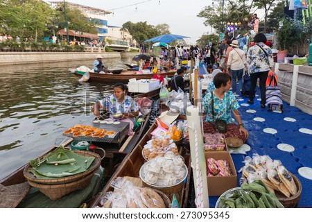BANGKOK, THAILAND, February 17, 2015: Food Sellers at the new Khlong Phadung Krung Kasem floating market who just opened the 12th February 2015 in the Thewet district in Bangkok, Thailand - stock photo