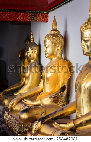 BANGKOK, THAILAND - FEBRUARY 19, 2015: Golden buddha images at Wat Pho (Wat Phra Chetupon Vimolmangklararm) in Bangkok, Thailand. - stock photo