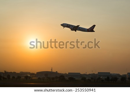 BANGKOK, THAILAND - FEBRUARY 05,2015: Passengers boarding airplane Airbus A320-200 of AirAsia takeoff at the Don Mueang airport. - stock photo