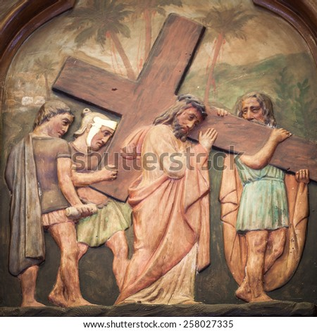 BANGKOK THAILAND - FEBRUARY 28 : The carving of Jesus, Simon of Cyrene at station V, good friday concept in church Thailand on February 28, 2015 - stock photo
