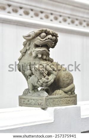 BANGKOK, THAILAND - FEBRUARY 19, 2015: The lion statue at Wat Phra Kaew in Bangkok, Thailand. - stock photo