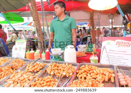 BANGKOK, THAILAND - :1 Febuary merchant sell a sausage in shopping market on Febuary 1 , 2015 in Bangkok, Thailand. Chatuchak (or Jatujak) weekend market is the largest market in Thailand. - stock photo