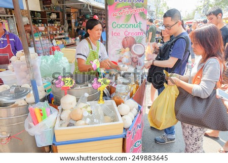 BANGKOK, THAILAND - :1 Febuary Tourists buying ice-cream in shopping market on Febuary 1 , 2015 in Bangkok, Thailand. Chatuchak (or Jatujak) weekend market is the largest market in Thailand. - stock photo