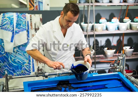"Bangkok, Thailand - Feburary 28, 2015:  HERMES Staff Demonstrations silk printing at Siam Paragon in ""FESTIVAL DES METIERS A RENDEZVOUS WITH HERMES CRAFTSPEOPLE"" event"