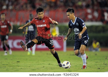 BANGKOK, THAILAND - JAN 11:  Adisak Klinklsum of the MuangThong United (L)in action during theThaicom FA Cup Final match between and Buriram PEA at National Stadium on January11,2012 in Bangkok Thailand. - stock photo