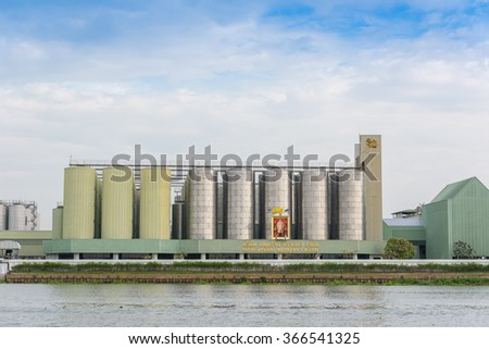 BANGKOK, THAILAND - Jan 20, 2016 : Beer producing factory along Chao Phra Ya river. Singha : Beer production capacity is 1 billion litres per year Recently Singha was the best selling beer in Thailand
