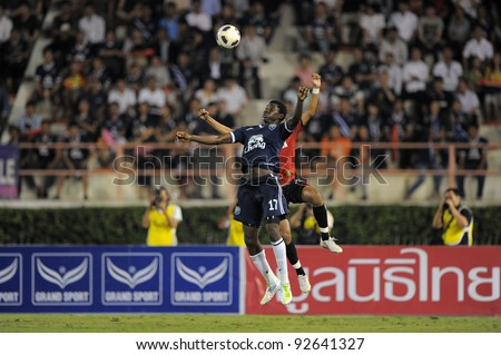 BANGKOK, THAILAND - JAN 11: Bouba Abbo of the Buriram PEA(L)in action during the Thaicom FACup Final match  between MuangThong United at National Stadium of Thailand on January11, 2012 in Bangkok Thailand. - stock photo