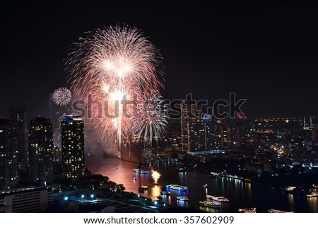 Bangkok, THAILAND - JAN 1:2016 Colorful fireworks festive countdown happy new year 2016 at Chao Phraya River.