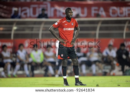 BANGKOK, THAILAND - JAN 11:  Dagno Siaka of the MuangThong United in action during theThaicom FA Cup Final match between and Buriram PEA at National Stadium on January11,2012 in Bangkok Thailand. - stock photo