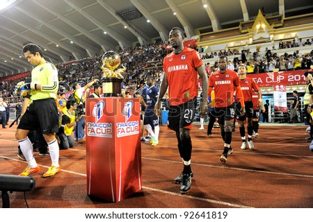 BANGKOK, THAILAND - JAN 11:  Dagno Siaka (R) of the MuangThong United in action during theThaicom FA Cup Final match between and Buriram PEA at National Stadium on January11,2012 in Bangkok Thailand.