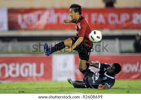 BANGKOK, THAILAND - JAN 11:  Datsakorn Thonglao of the MuangThong United (L)in action during theThaicom FA Cup Final match between and Buriram PEA at National Stadium on January11,2012 in Bangkok Thailand. - stock photo