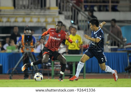 BANGKOK, THAILAND - JAN 11: Diarra Ali of the MuangThong United (L)in action during theThaicom FA Cup Final match between and Buriram PEA at National Stadium on January11,2012 in Bangkok Thailand. - stock photo