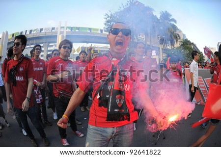 BANGKOK, THAILAND - JAN 11:  Fans of the MuangThong United in action during theThaicom FA Cup Final match between and Buriram PEA at National Stadium on January11,2012 in Bangkok Thailand. - stock photo