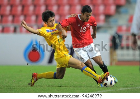 BANGKOK THAILAND-JAN18: Harmeet Singh of  Norway  (red) in action during the 41st King's cup  between Thailand and Norway at Rajamangala stadium on Jan 18, 2012 in Bangkok,Thailand.