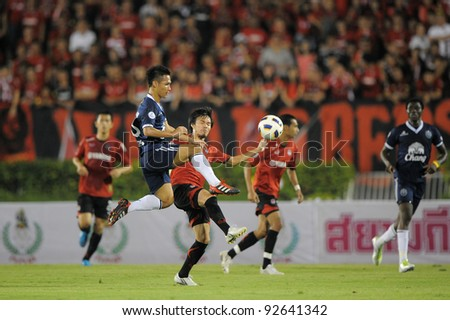 BANGKOK, THAILAND - JAN 11: Jakkraphan Kaewprom of the Buriram PEA (L) in action during the Thaicom FA Cup Final match  between MuangThong United at National Stadium on Jan11, 2012 in Bangkok Thailand. - stock photo