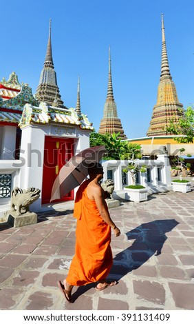 BANGKOK, THAILAND - JAN 5: Monk looking to the Wat Pho, also know as the Temple of the Reclining Buddha January 5, 2016 in Bangkok. There are an estimated 460,000 monks in Thailand. - stock photo