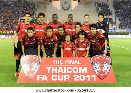 BANGKOK, THAILAND - JAN 11:  MuangThong United team line up during theThaicom FA Cup Final match between and Buriram PEA at National Stadium on January11,2012 in Bangkok Thailand.