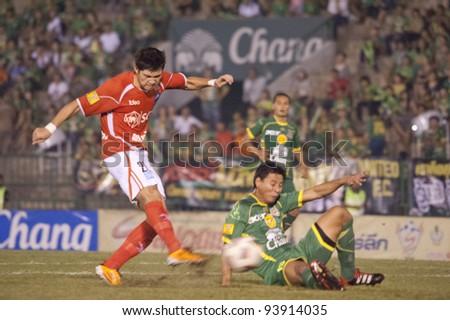 BANGKOK THAILAND - JAN 28 : N.Tumrongsuppakron (L) in action during Thai Premier League (TPL) between Army Utd. (green) vs Samutsongkham (Red) on February 28, 2012 in Army Stadium in Bangkok Thailand - stock photo