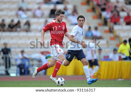 BANGKOK THAILAND-JAN15:Ovrnskov Martin (17) of  Denmark in action during the 41st King's cup football tournament between Norway and Denmark at Rajamangala stadium on Jan 15, 2012 Bangkok, Thailand.