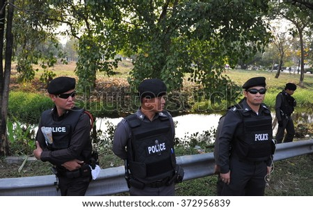 BANGKOK, THAILAND - JAN 27, 2014: Police officers stand guard at a crime scene of a fatal shooting of a political activist.  - stock photo