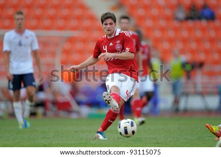 BANGKOK THAILAND-JAN 15:Thomas Drage (4) of Denmark  in action during the 41st King's cup football tournament between Norway and Denmark at Rajamangala stadium on Jan 15, 2012 Bangkok, Thailand.