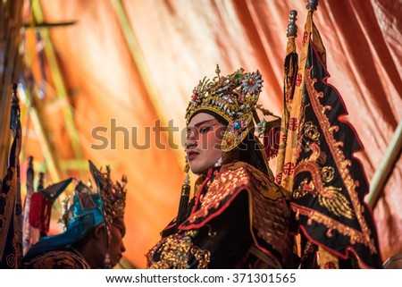 BANGKOK, THAILAND - JANUARY 14, 2016: A Chinese actor is doing make up before the show of traditional Chinese opera. - stock photo