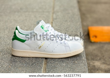 BANGKOK, THAILAND - JANUARY 23, 2017: Adidas stan smith classic shoes on  ground