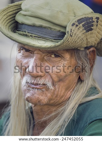 BANGKOK, THAILAND - JANUARY 21, 2015: An unidentified man living in a poor district of Bangkok Klong Toe. Khlong Toei is one of Bangkok's poorest areas. - stock photo