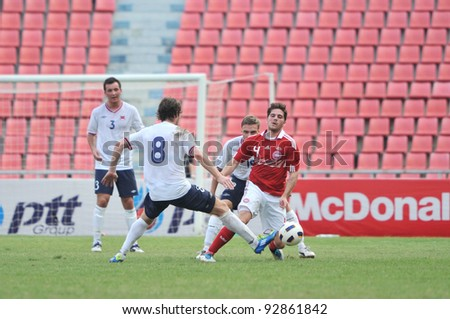 BANGKOK THAILAND - JANUARY 15 : C.Soeren (R) in action during KING'S CUP 2012 between Denmark vs Norway on January 15, 2012 in Rajamangla Stadium,Bangkok, Thailand.